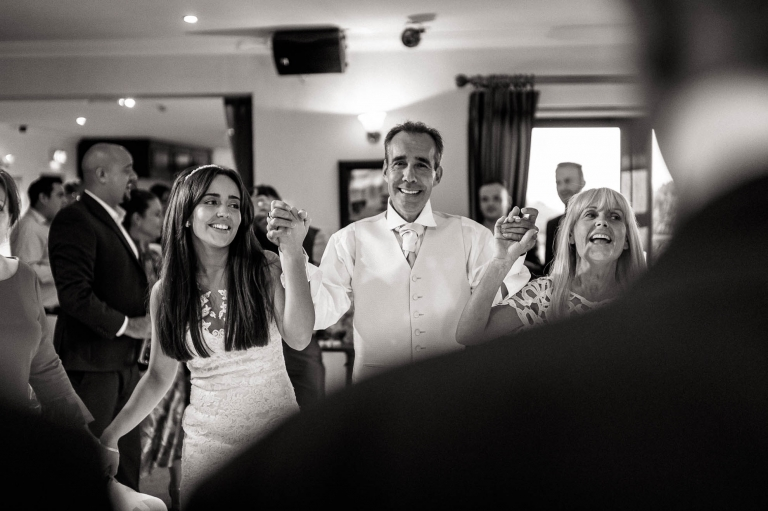 The bride dances hand in hand with her father