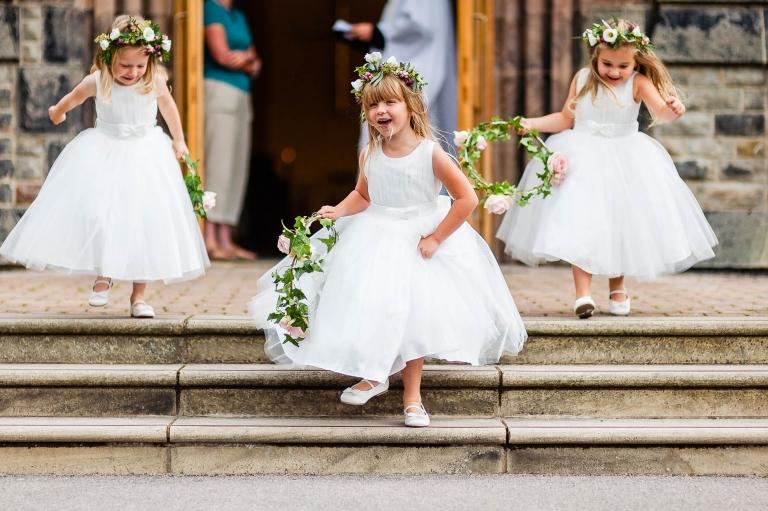 Flower girls play outside church