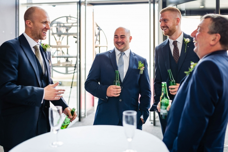 best man tells a joke to wedding guests