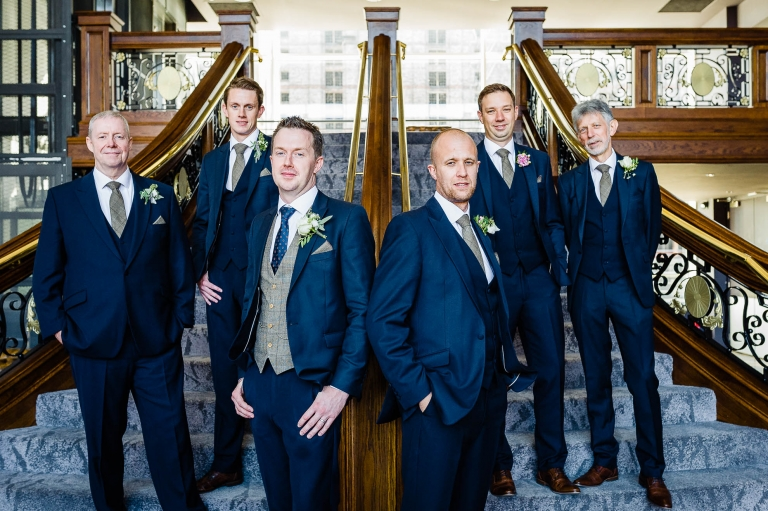 groom and his groomsmen group photograph on titanic staircase