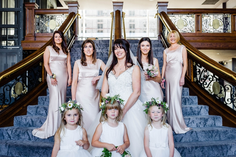 bride and her bridesmaids group photograph on titanic staircase