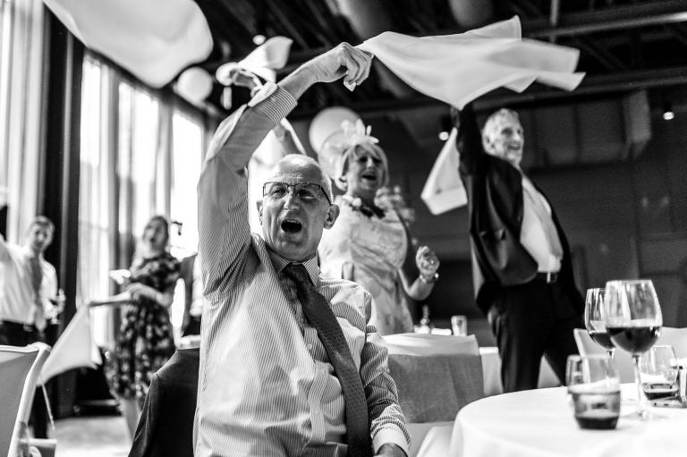 wedding guests wave napkins