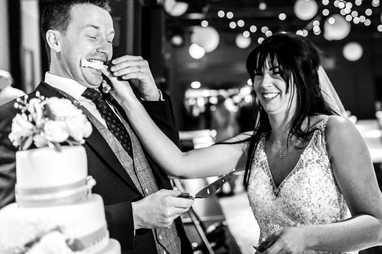 The bride feeds the groom wedding cake