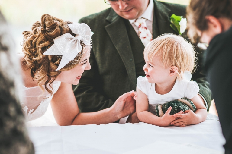 The bride and her daughter share a moment