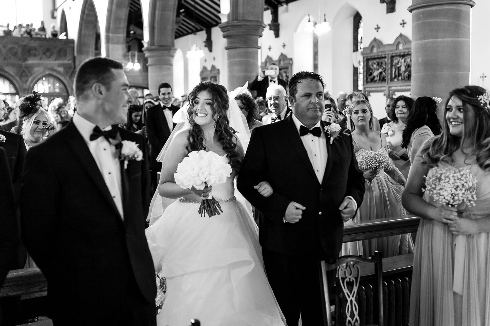 Groom turns to see his bride as she walks up the aisle